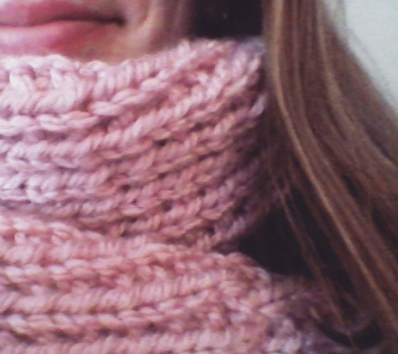 Picture of a pink knitted scarf