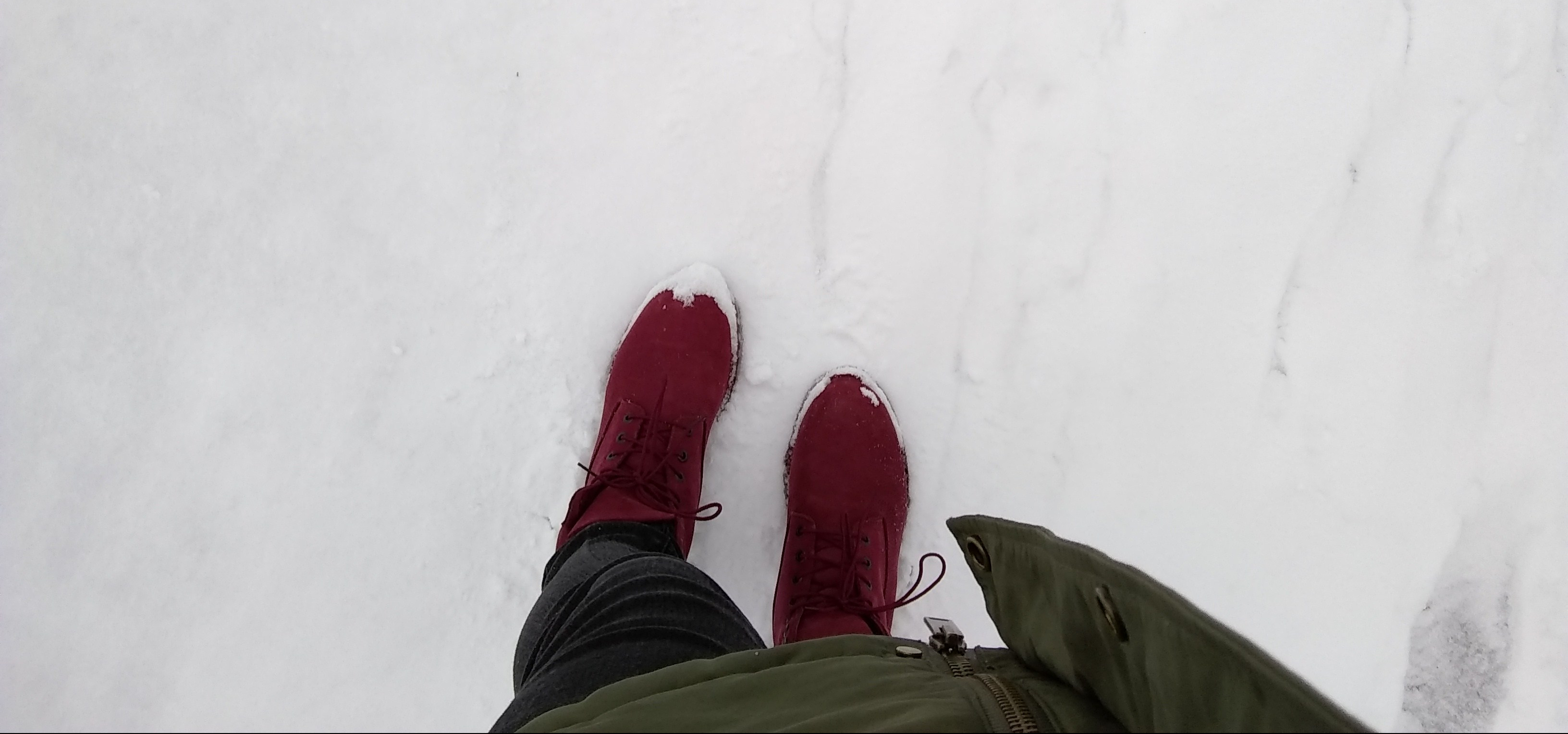 Walking on snow with boots.
