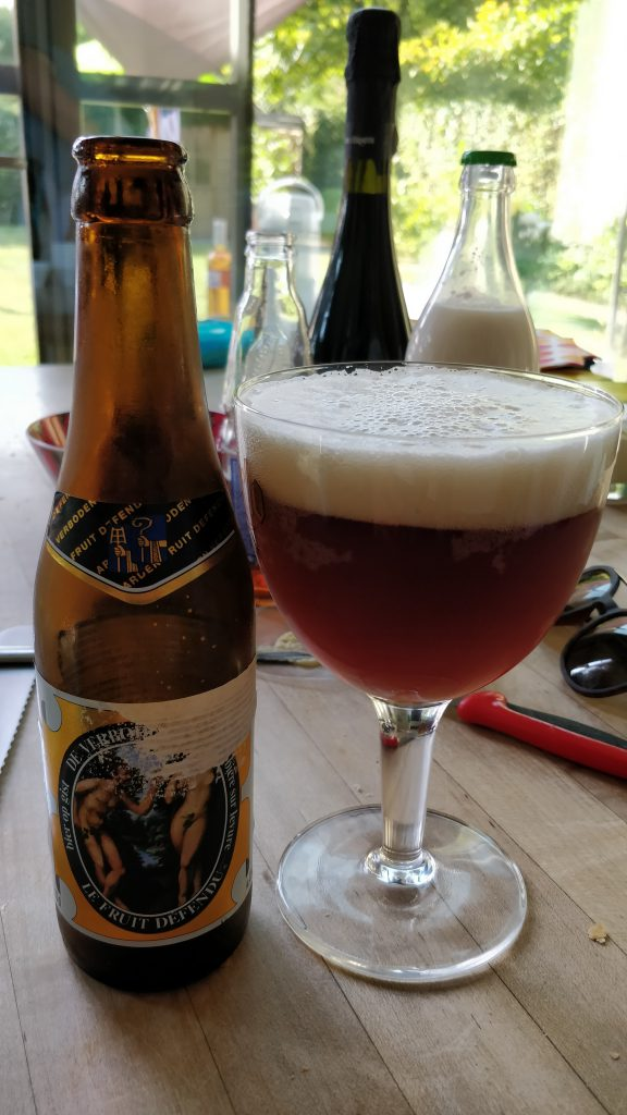 A bottle of St. Bernandus beer poured into a glass.