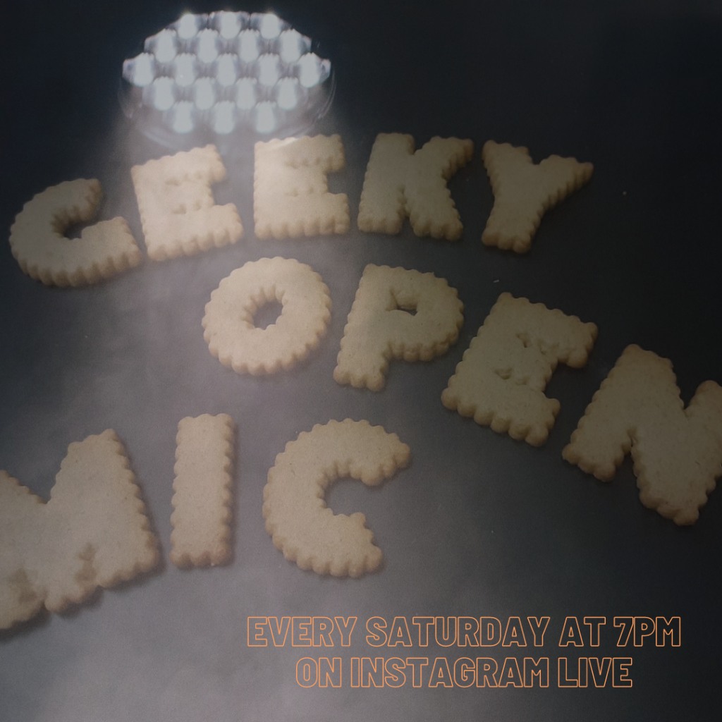 "Cookies Spelling Out  ""Geeky Open Mic"" under a spotlight"