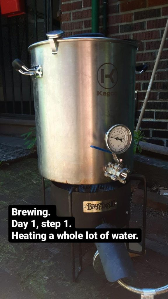 Picture of a big, 10 gallon pot on a gas burner. Text: Brewing. Day 1, step 1. Heating a whole lot of water.